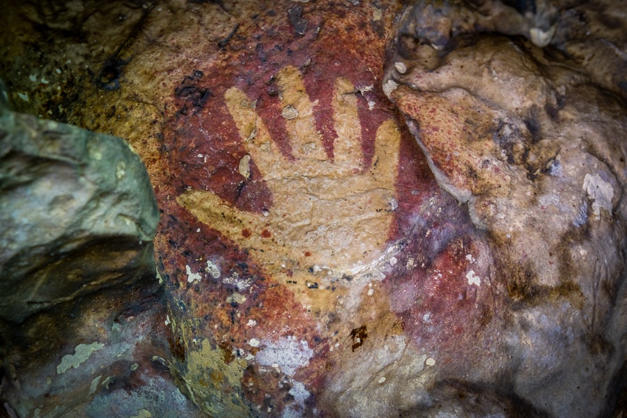 Prehistoric cave art hand print in Rammang Rammang Maros