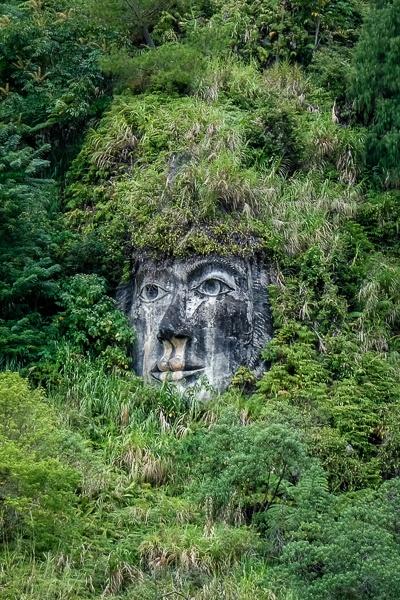 Lumimuut stone face in Tomohon