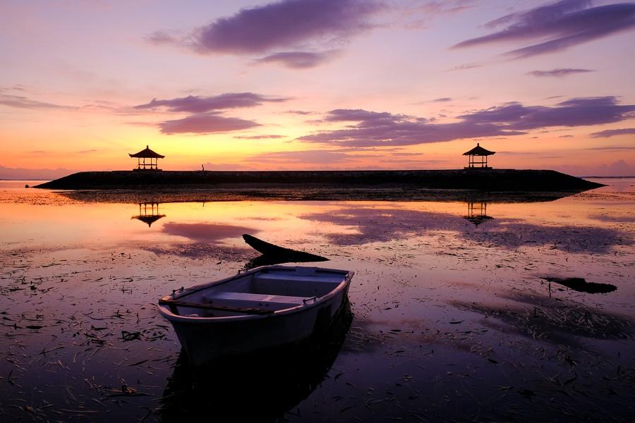 Boat reflection at a Sanur Beach Sunrise in Bali