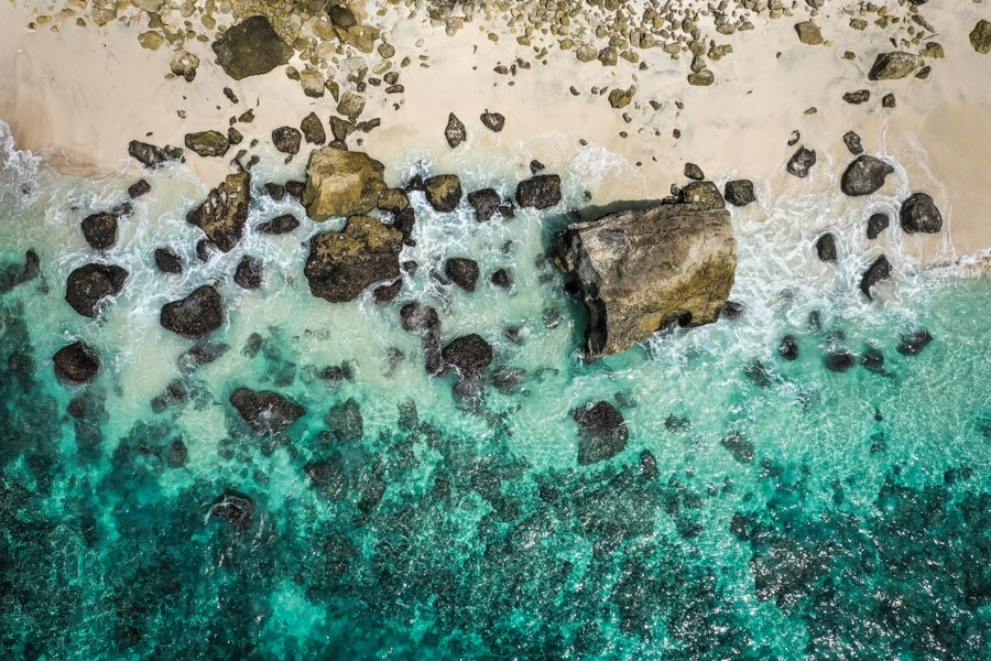 Beach waves rocks drone