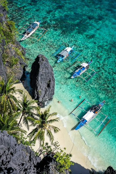 Drone view of Entalula Beach and boats in El Nido, Palawan, Philippines