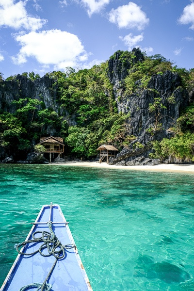 Boat on turquoise water in El Nido Palawan