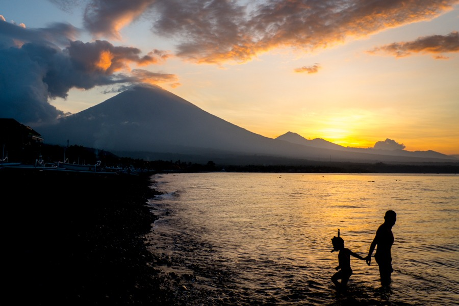 Father and son at the Amed Beach sunset in Bali