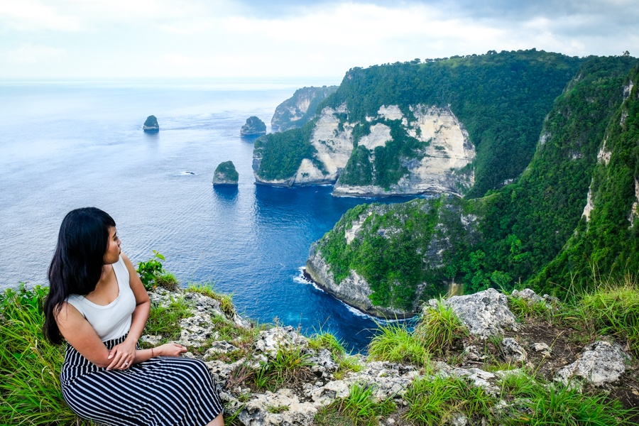 My woman staring at the coast at Saren Cliff Point in Nusa Penida, Bali