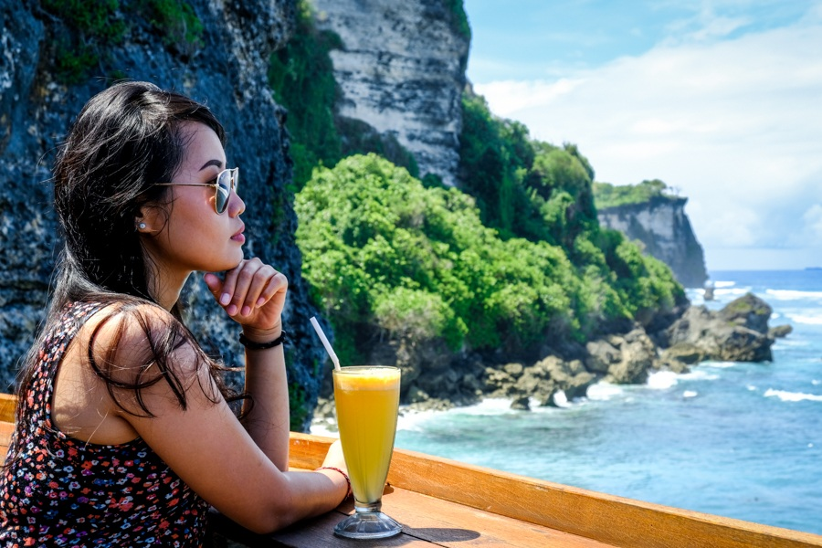 My woman with a drink at the Suluban cliff restaurant in Bali