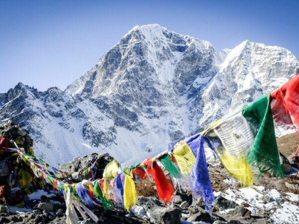 Nepali prayer flags and snowy mountain on the Everest Base Camp EBC Trek in Nepal
