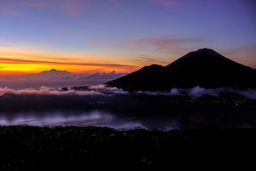 Mount Batur sunrise with purple and orange colors in Bali