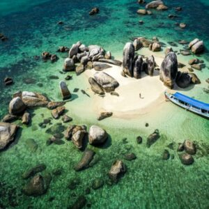 Island hopping boat tour at Batu Berlayar island in Belitung Indonesia