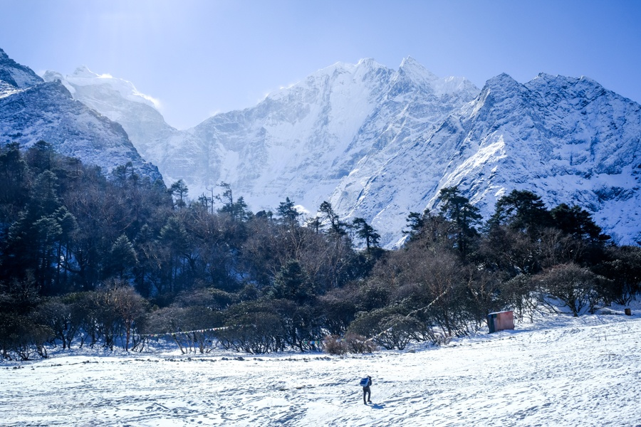 Hiker walking on the snow near Tengboche on the EBC Trek in Nepal