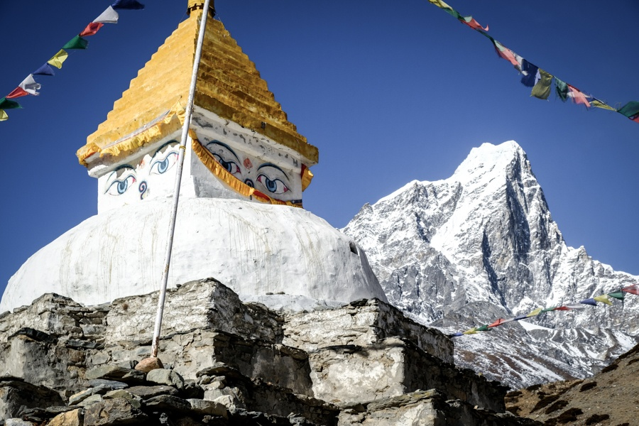 Stupa face and mountain near Dingboche on the EBC Trek in Nepal