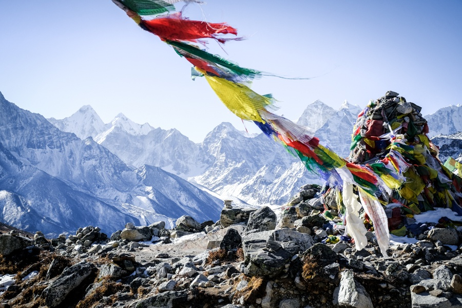 Prayer flags with white Nepal mountains in the distance at the EBC trek