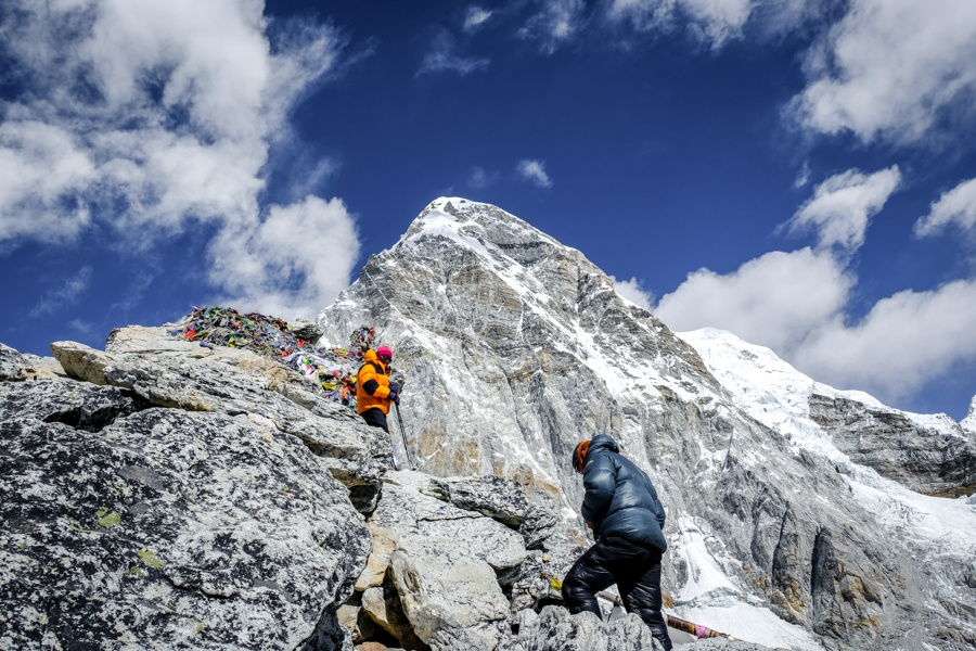 Hikers near Pumori Peak and Kala Patthar on the Everest Base Camp trek in Nepal