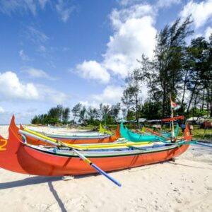 Traditional boats at Pantai Serdang Beach in Belitung