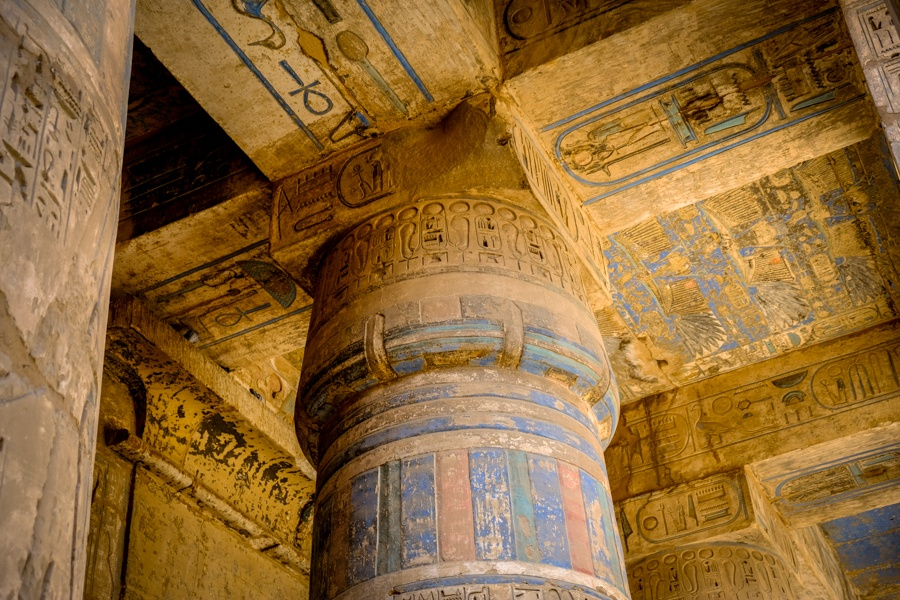 Hieroglyphs on the pillars at Medinet Habu Temple in Egypt