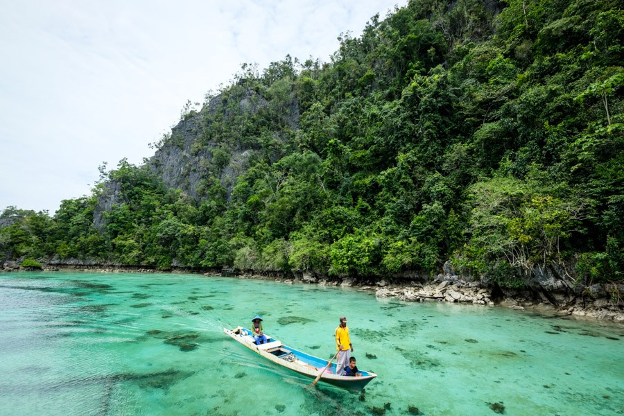 Boat man in Sulawesi lagoon