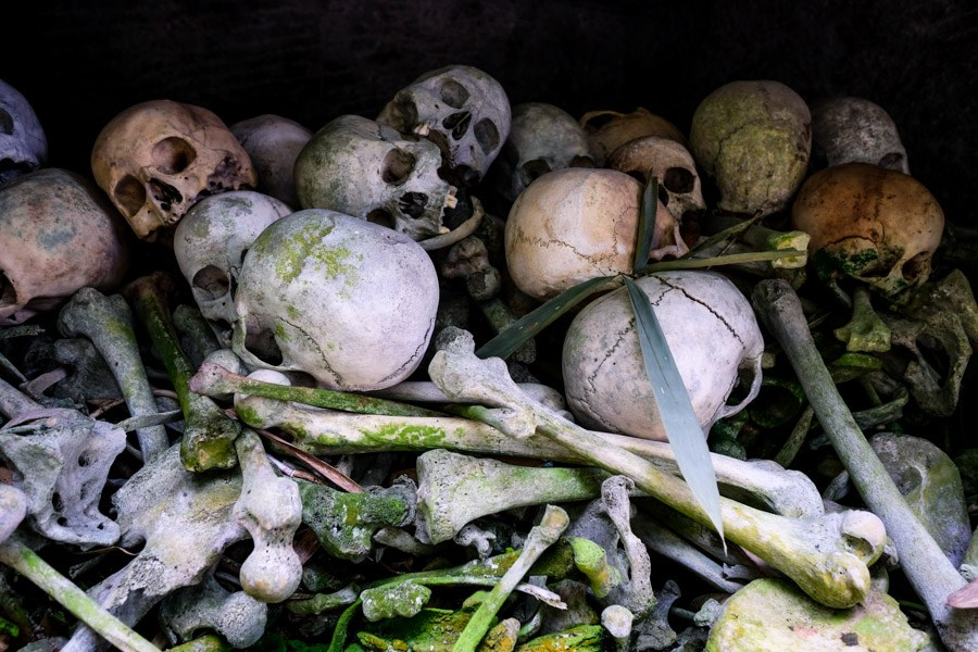 Skeletons and bones inside a tomb at Bori