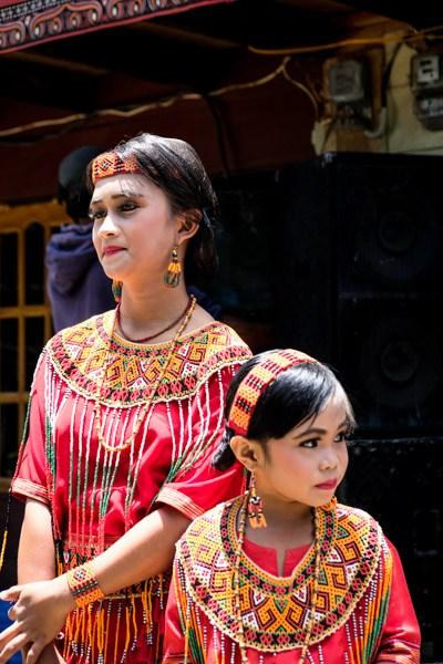 Tana Toraja girls wearing traditional dress in Indonesia
