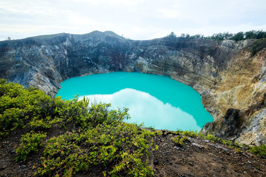 Blue crater lake at Kelimutu National Park in Flores Indonesia