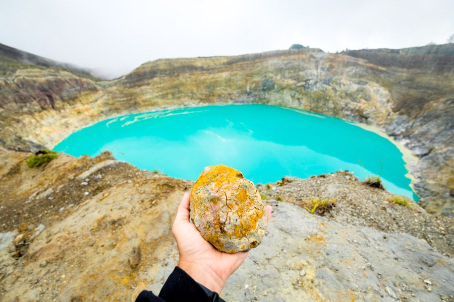 Orange and blue crater lake in Flores Indonesia